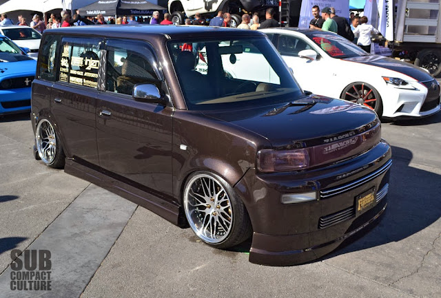 Slammed brown Scion xB
