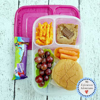 Lunch box fun with a turkey and cheese sandwich on a potato roll hamburger bun. In our @easylunchboxes #lunchboxideas