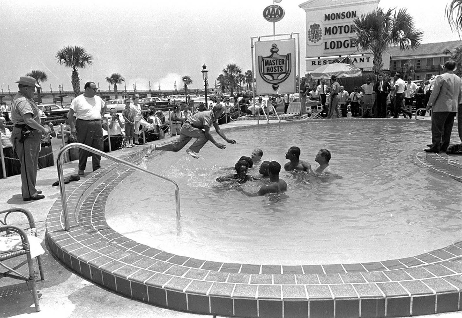 When a group of white and black integrationists refused to leave a motel swimming pool in St. Augustine, Florida, this man dove in and cleared them out on June 18, 1964. All were arrested.