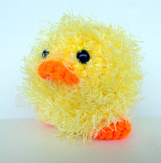 Crochet amigurumi little yellow fluffy chick