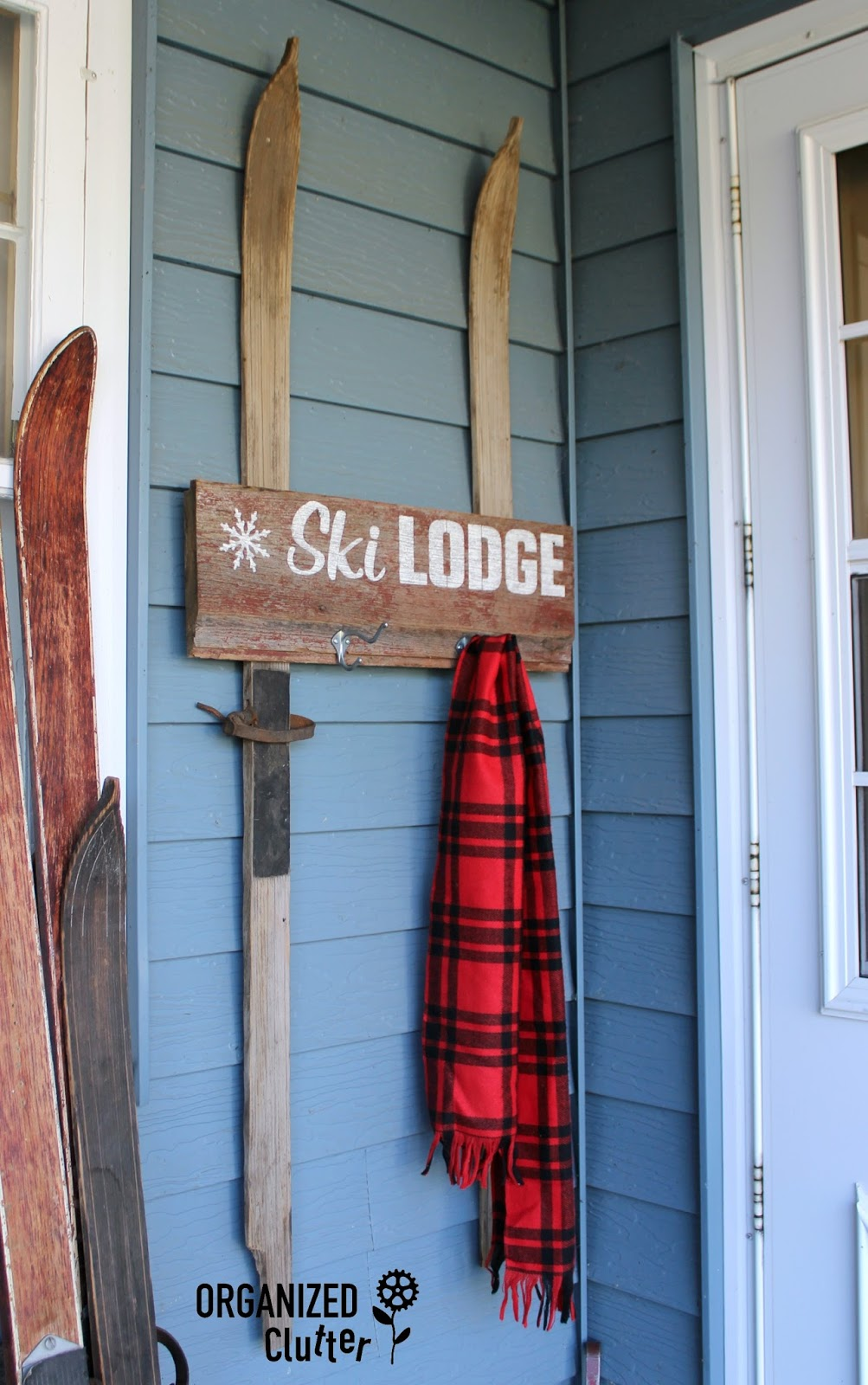 A New Ski Lodge Sign With Old Sign Stencils Organized