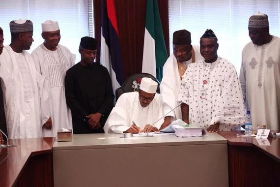 0 Photos: President Buhari signs the 2016 Budget