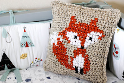 http://www.sewrella.com/2016/05/how-to-cross-stitch-on-crochet.html