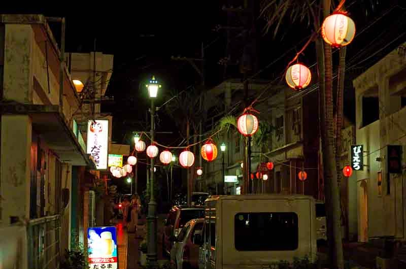 paper lanterns line a street at night,festival