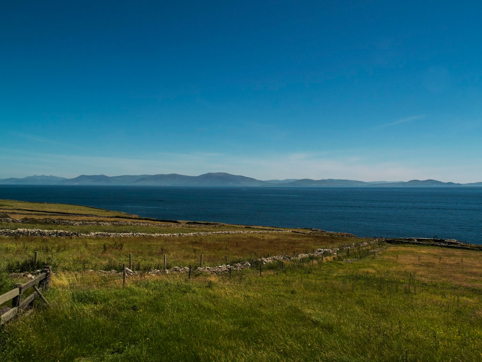 View of the Iveragh Peninsula from Dingle Peninsula on a sunny day.