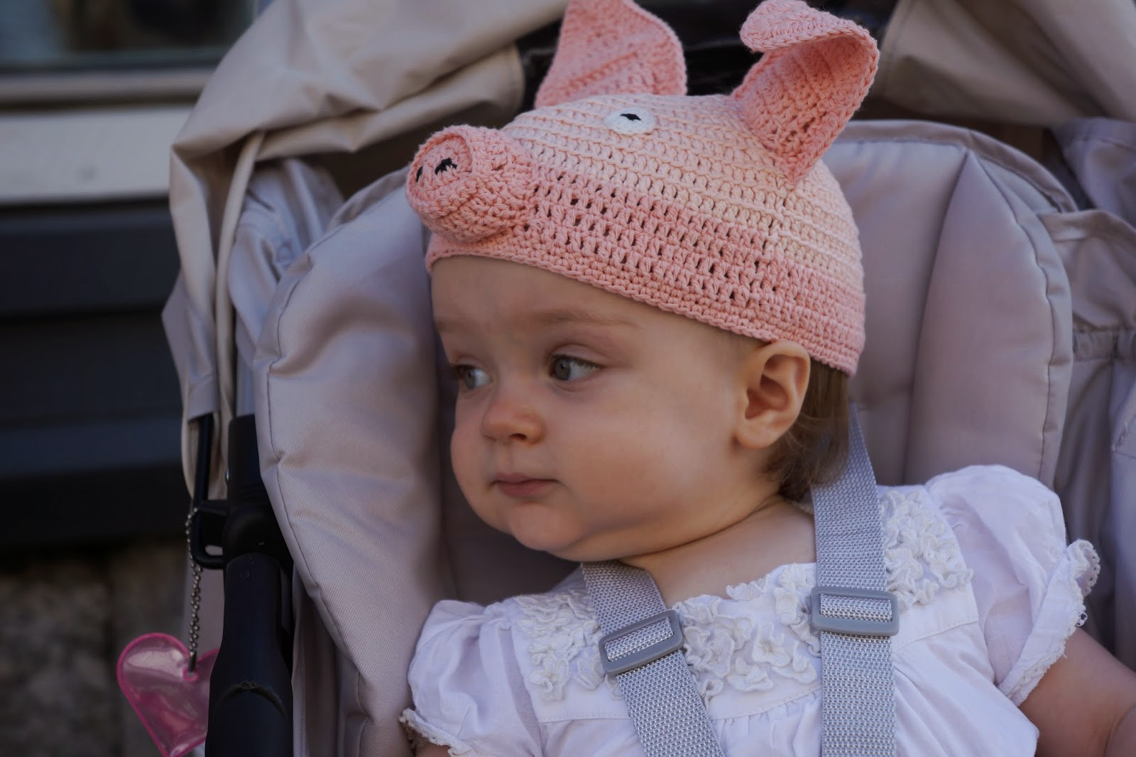 baby in a crocheted piggy hat