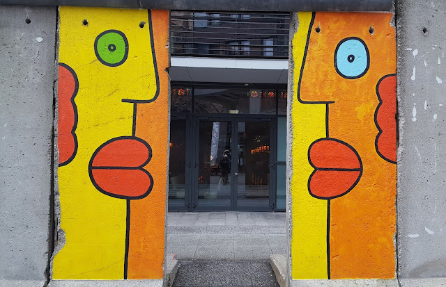 Two segments of berlin wall painted with two faces