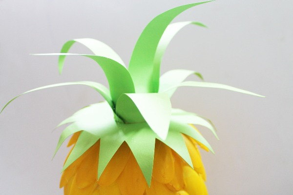 Cut the spines slightly to different sizes and finally shape to make them look perfectly pineappley