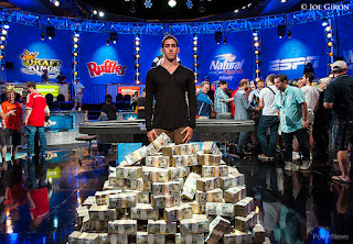 Dan Colman standing in front of millions after winning the Big One for One Drop