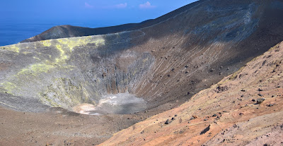 View of the Gran Cratere of Vulcano. People can be seen at the bottom of th crater.