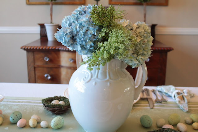 classic easter tablescape centerpiece white ironstone pitcher blue hydrangeas greens gorgeous