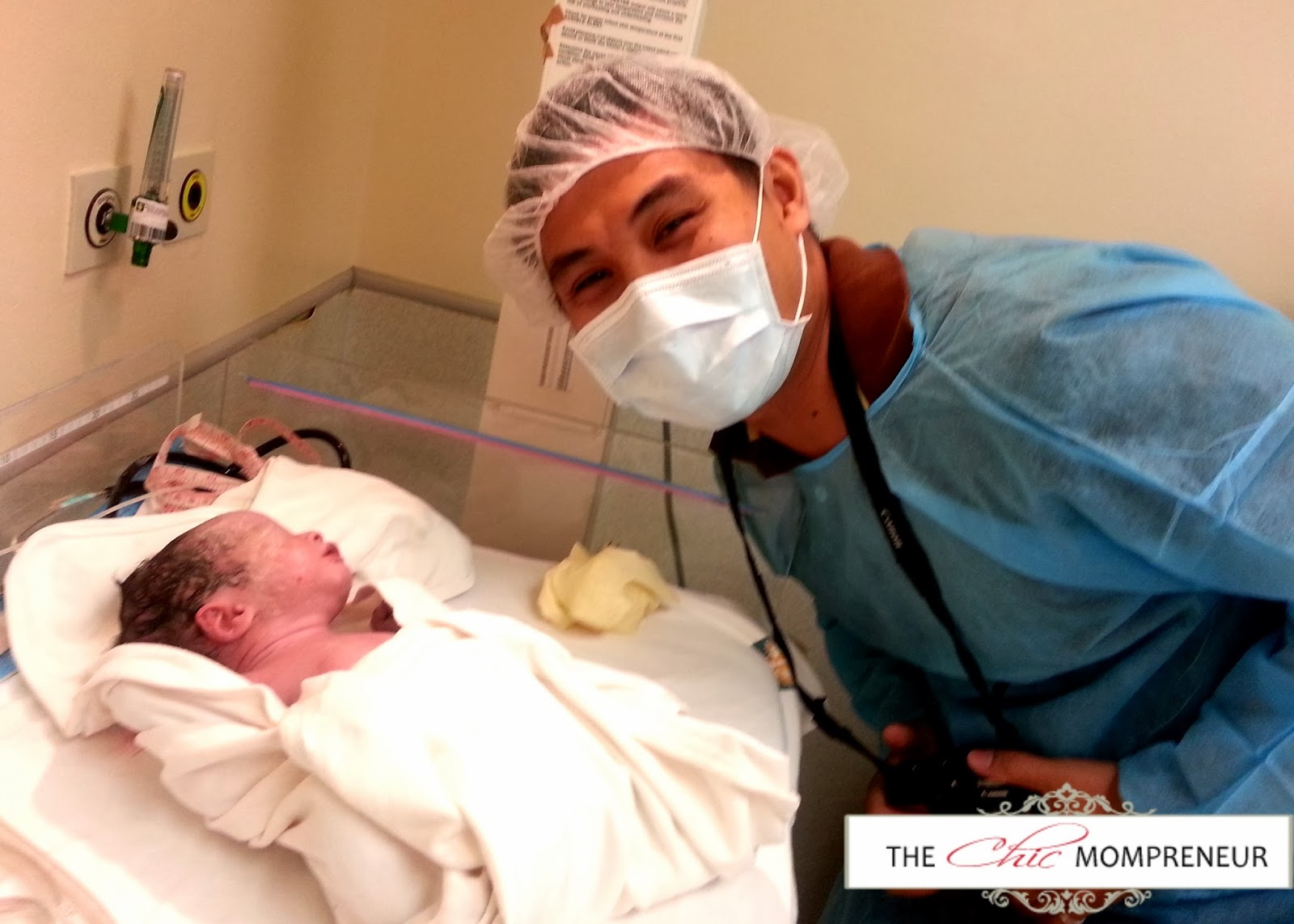 Daddy's first picture with Kali! Kali was brought to a heated portion of  the operating room.