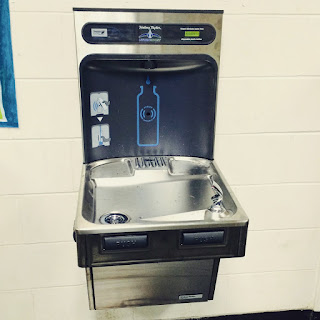 This image showcases one of the school's new water refill station located on the first floor.