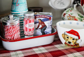 Hot cocoa station with vintage enamelware and red plaid runner