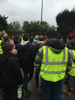 Volunteer briefing at L'Auberge des Migrants warehouse in Calais