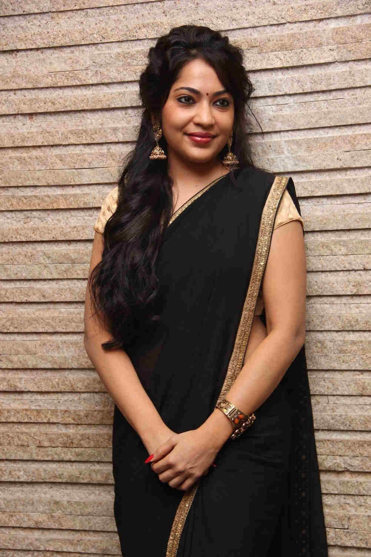 Tamil VJ Ramya Spicy Stills In Transparent Black Saree