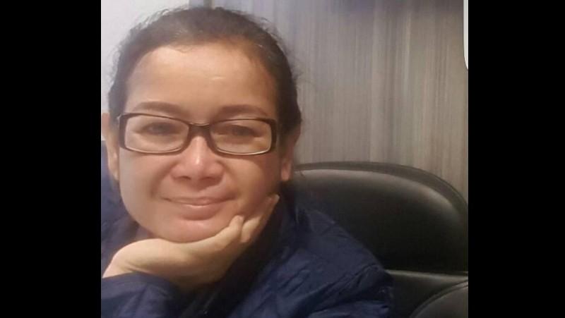 Miryam S Haryani tersenyum saat ditangkap