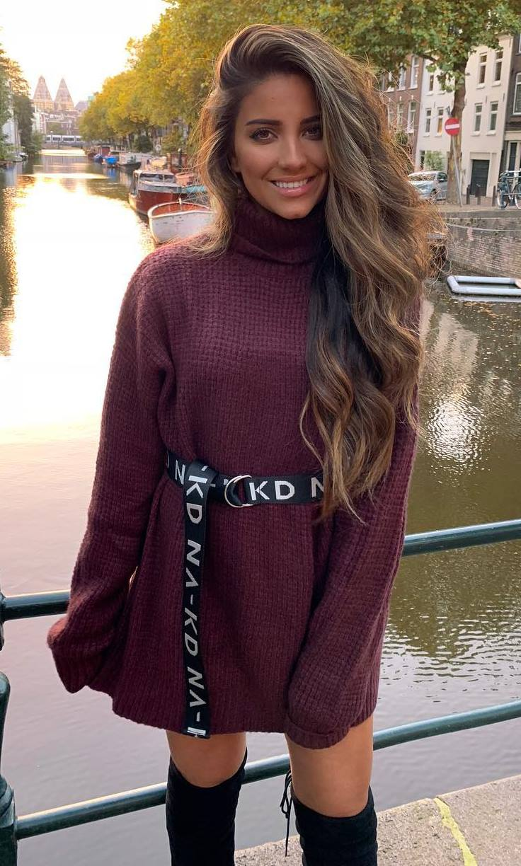 how to style a burgundy sweater dress : printed belt and over knee boots