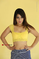 Cute Telugu Actress Shunaya Solanki High Definition Spicy Pos in Yellow Top and Skirt  0152.JPG