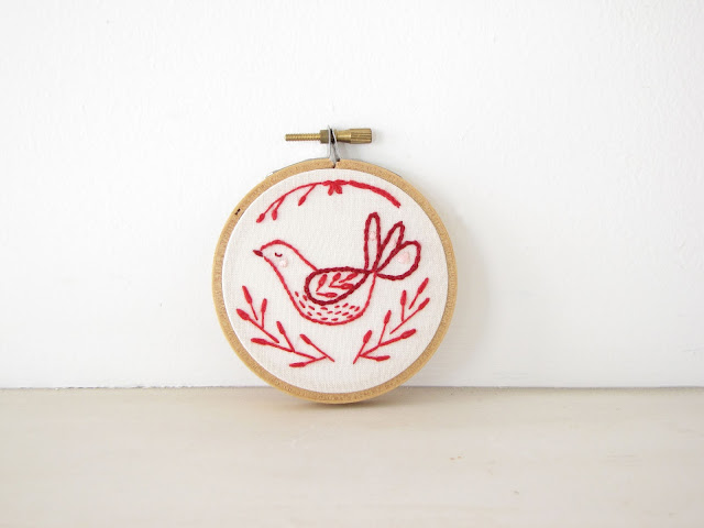 "🔎zoom  Request a custom order and have something made just for you. Description A hand-embroidered bird with branches inspired by Scandinavian folk art designs, with red embroidery thread on cream cotton fabric. Stretched on a 3-inch wooden hoop painted in red, ready to hang or place in your home. Also makes a lovely gift :)  Please convo me if you have any questions! Reviews 5 out of 5 stars     (316)   Reviewed by Natasha Piedallu van Wyk 5 out of 5 stars    Mar 6, 2018 Athena and Eugenia's mini banners are beautifully made and just as pictured. This is the second banner I've purchased. I use them to decorate my kid's rooms after I've finished using them to decorate their birthday cake!  Lemon & Lavender Birthday Cake Topper - Fabric Bunting - Wedding, Baby Shower Decor yellow grey floral purple spring garden party   Reviewed by Nicole Ferring 5 out of 5 stars    Feb 7, 2018 Perfect. Thank you. Fast shipping.  Mother Goose Cake Topper - Fabric Cake Bunting, Wedding, Birthday Party, Shower Decoration, pastel pink teal green floral gingham fairy tale   Reviewed by Mary Beth Haselfeld 5 out of 5 stars    Jan 16, 2018  Botanical Garden Cake Topper - Fabric Cake Bunting, Wedding, Birthday Party, Shower Decoration - floral pink green lavender aqua nature   Reviewed by Katherine Buyer photo Katherine, who reviewed this item with the Etsy app for iPhone. 5 out of 5 stars    Dec 30, 2017 Loved the banners unfortunately I misplaced ""the joy banner"".  Peace Joy Love Cake Topper, Christmas Decoration Banner, Personalized Cake Bunting, Custom Party Decor holiday garland navy red yellow dots+ More Payments  Secure options      Accepts Etsy Gift Cards and Etsy Credits Etsy keeps your payment information secure. Etsy shops never receive your credit card information.   + More Returns & exchanges We hope you love what we make! If in any way you are unhappy with your item, please convo us and send it back in its original condition within 14 days. Upon receiving it we will refund you the full amount for the item, but not for shipping.   For damaged items: If your item has been damaged during shipping, again please send it back within 14 days and we will either refund you or replace the item once we receive it.   Please note that after 14 days these terms will not apply. Shipping policies Orders are mailed Monday through Friday. The default shipping option is via USPS first class mail. Shipping time for US orders is generally 3-4 business days. Priority shipping (US orders only) is available as an option for items listed. Priority shipping includes tracking and takes about 2-3 business days.   We ship to the address listed on your Etsy account, so please be sure that it is correct. We are not responsible for shipping to an address that is inaccurate or not current.   * Cake toppers/cake buntings are shipped in a standard envelope. The shipping does not include tracking, but if you would prefer to add tracking please let me know and I will adjust the shipping price accordingly.  * Embroidery hoops and home decor items are securely packaged. Tracking is included with these items. * Cards are packaged in a rigid photo mailer.   International orders are sent first class international mail. This does not include tracking or insurance. We frequently ship overseas, and the approximate time for international shipping is about two to three weeks. Please be aware, however, that due to customs it may take up to 8 weeks or more. Also, please note that you are responsible for any customs fees, duties and taxes.  Should there be any delay in your receiving your item once it has been shipped, please contact us at your earliest convenience so we can remedy the situation. We do our best to send orders out as soon as possible. Though we cannot guarantee or be responsible for shipping times once your item has been mailed, we are willing to work things out if something goes amiss.    + More Additional policies Do you offer custom orders? Yes, we love custom orders! Please let us know how we can make something special for you.   The wooden dowels are not included with my cake topper. Where can I find them? The wooden dowels used in the photos are actually 12-inch bamboo skewers, which can be found at most supermarkets, usually in the baking aisle. You can also purchase long lollipop sticks in the candy-making section of your local craft store, or use colored or paper straws.  Meet the owner of AthenaandEugenia Learn more about her shop and process   Athena Folk Art Bird Embroidery Hoop Art, Hand embroidered red Scandinavian bird, Christmas holiday home decor, nature wall art, handmade ornament athenaandeugenia"