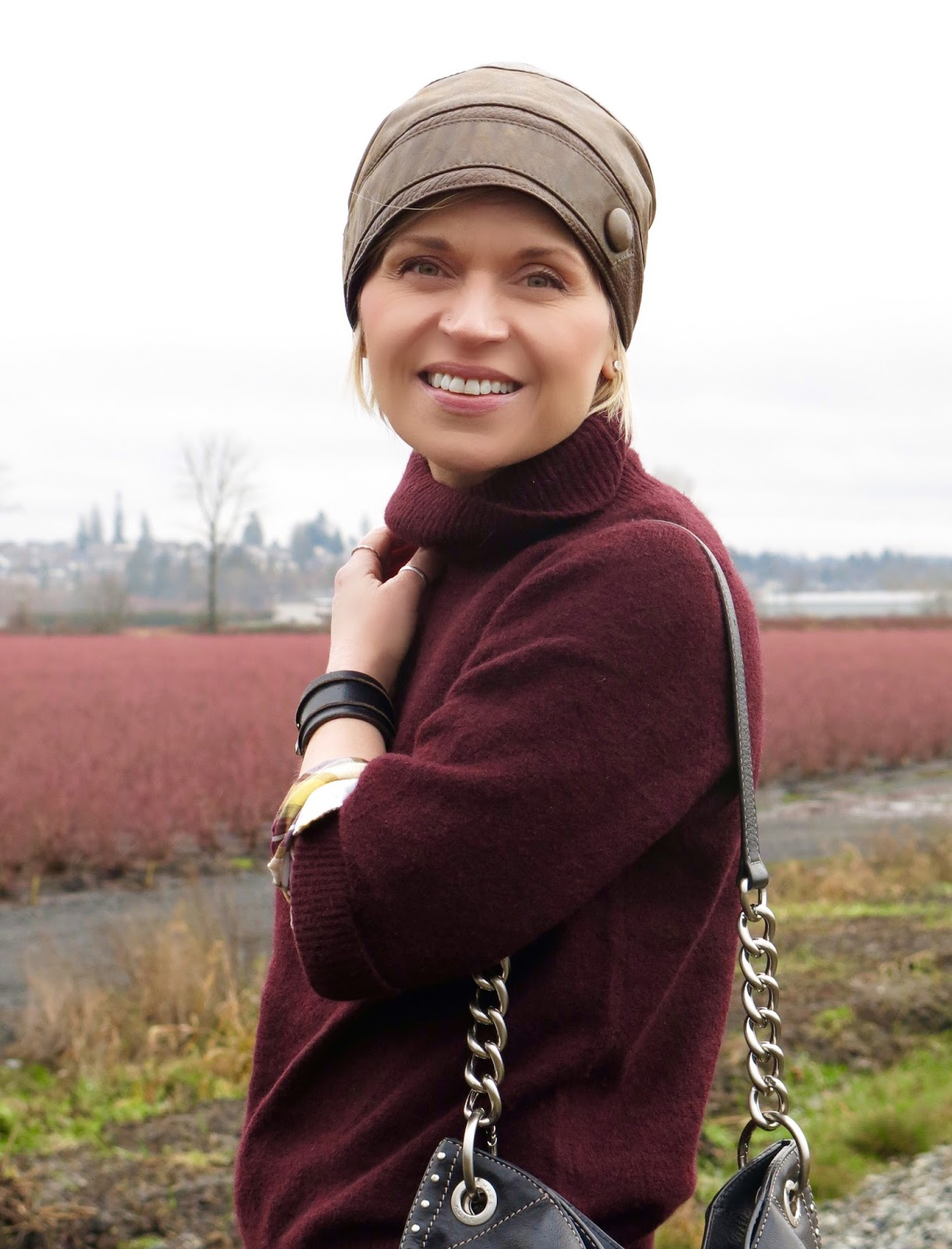 maroon wool turtleneck, leather beanie