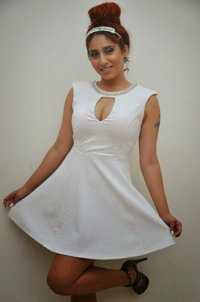 Singer Neha Basin Latest White Dress Hot Cut Gallery