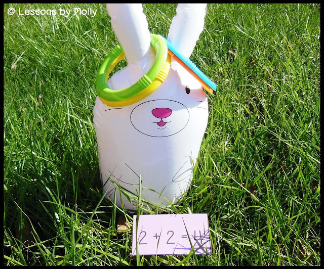 Turn a ring toss game into an outdoor math station for first graders!  Use addition sentence cards and let the learning fun begin!  Students withdraw a card from a bag or hat which has an addition sentence written on it.  Children create the corresponding math fact by placing the rings on the left or right ear of an inflatable bunny.  There is a free set of addition sentences that can be downloaded from this blog post.  The cards include addition facts (two addends) for sums from zero to ten.