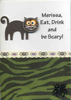 A spooky black cat is on the front of this halloween card. Personalized with a name