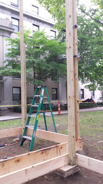 vertical posts and ground-floor spandrel beams installed