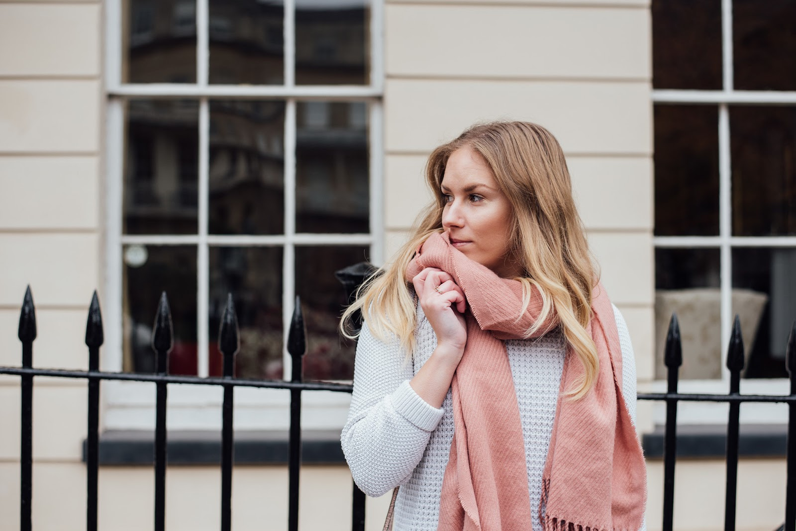 Rachel Emily wearing a white jumper and Pieces Pink Boucle Scarf Available from ASOS
