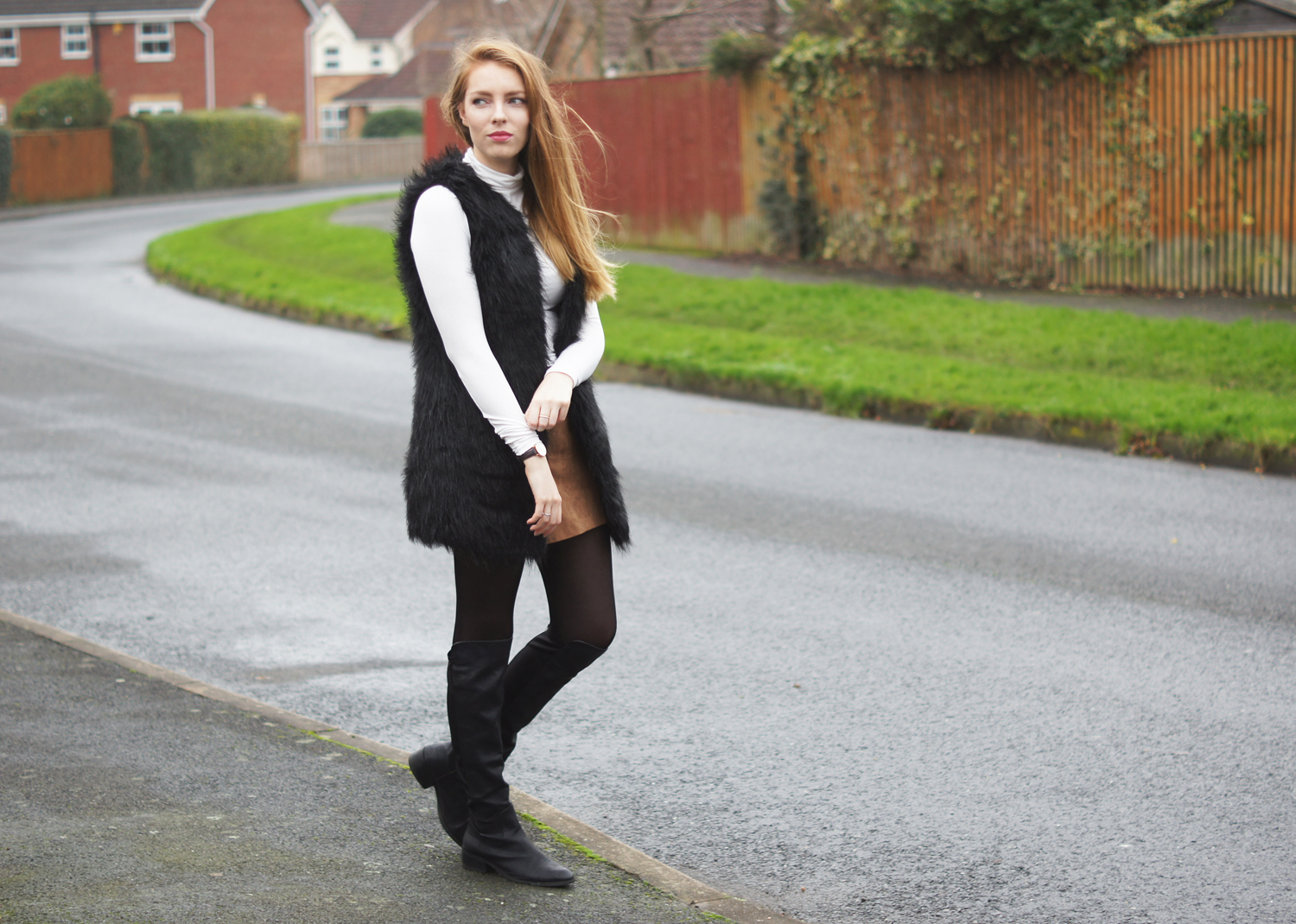 white roll neck and black fur gilet