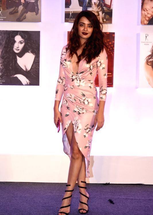 Surveen Chawla Log Cross Legs Thighs Photos In Pink Dress