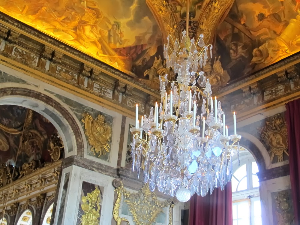 Ornate chandeliers at the Palace of Versailles