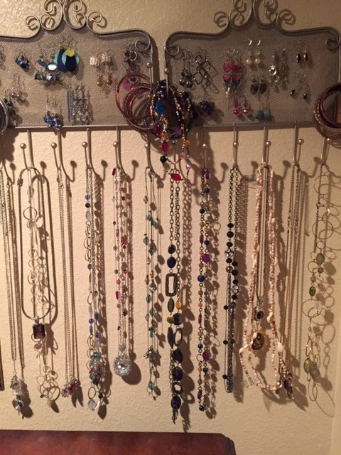 Hang a jewelry organizer on the wall of your closet to keep your jewelry organized.