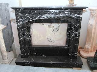 Портал камина из темного натурального камня