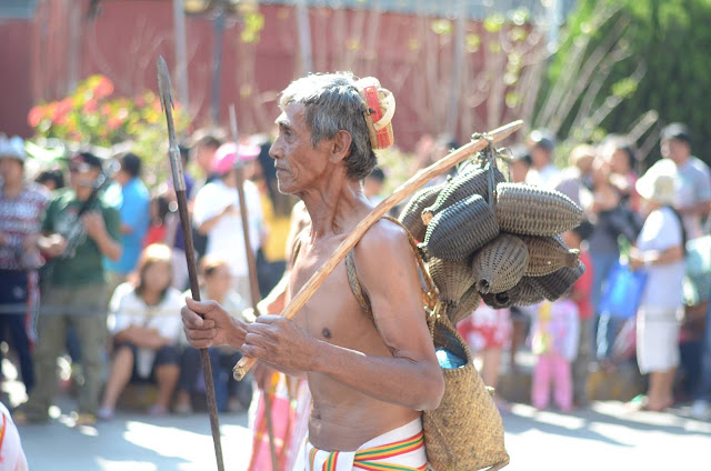 Indigenous Parade Man with Assorted Small Woven Bags