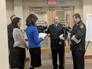 Assistant Town Clerk Nancy Danelo (in blue) swearing in the new Deputy chiefs