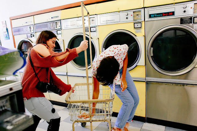 behind the scenes with model in laundromat