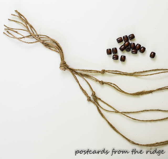 wood beads and knotted twine
