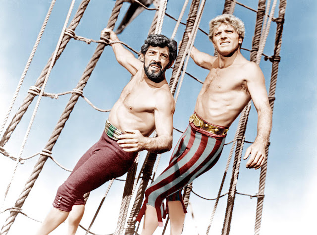 Publicity photo of Burt Lancaster in The Crimson Pirate, 1952. Burt looking sassy in bright stripped leggings and gold belt. Freelance Piracy marchmatron.com