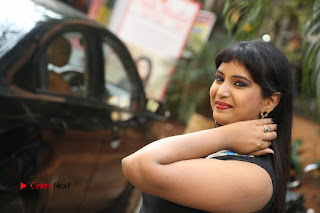 Actress Model Poorni Stills in Floral Long Dress at Silk India Expo Launch  0038.JPG