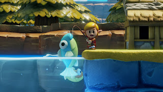 Link looks in the camera after catching an Ol' Baron. The fish is blue and huge.