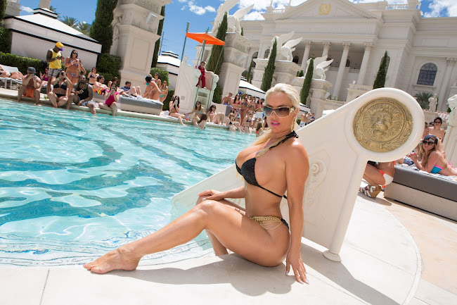 Nicole Coco Austin strikes a pose in a Tiny Bikini for paps
