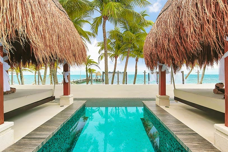 Swimming pool and swinging beds in Modern villa on the beach in Mexico