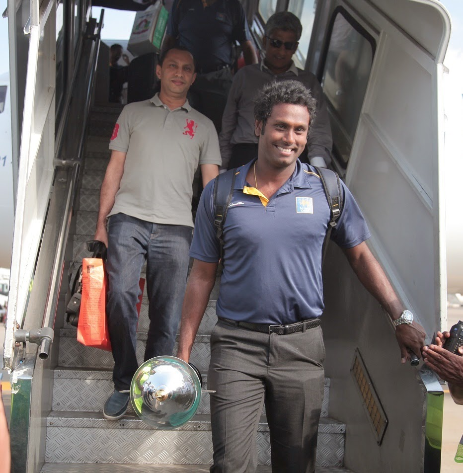 Angelo Mathews, the Captain of the Sri Lankan Cricket team, disembarking the Mihin Lanka flight when they touched down in Sri Lanka.
