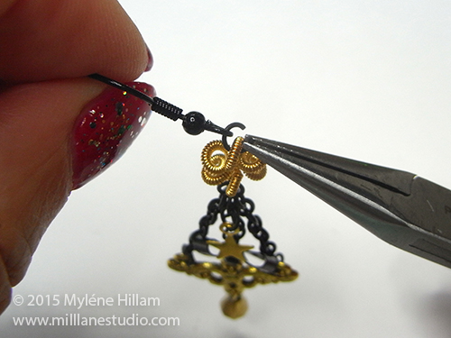 Attaching the earring wire to the earring component.