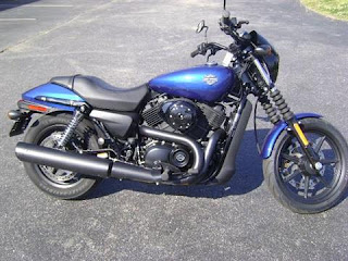 A blue pre-owned motorcycle