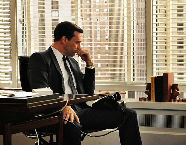 Don Draper's office space from Mad Men features dark stained wood and elegant bookends.