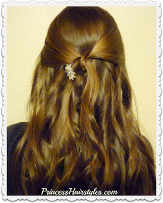 Simple half up hairstyle for Prom with rhinestone clip.