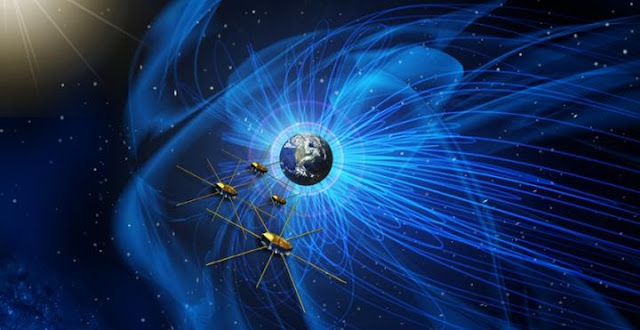 This artist's rendition shows the four identical MMS spacecraft flying near the sun-facing boundary of Earth's magnetic field (blue wavy lines). The MMS mission has revealed the clearest picture yet of the process of magnetic reconnection between the magnetic fields of Earth and the sun -- a driving force behind space weather, solar flares and other energetic phenomena. Credit: NASA